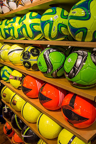 Multi-color Soccer Balls on shelves
